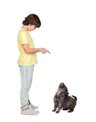 Child taught to obey his puppy isolated on white background