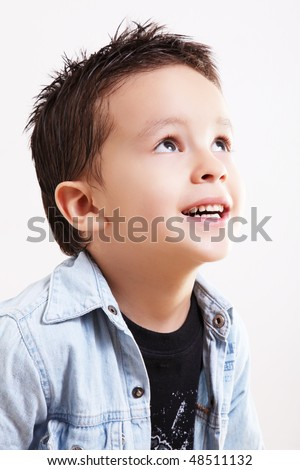 Child thinking and looking happy up over white background