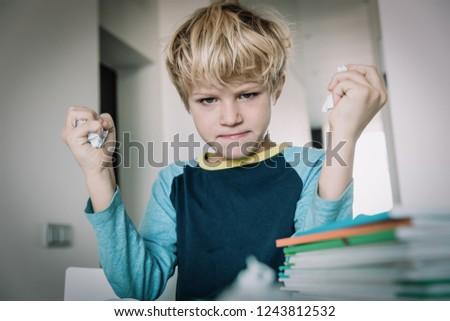 child tired stressed of doing homework, bored, agressive Stock photo ©