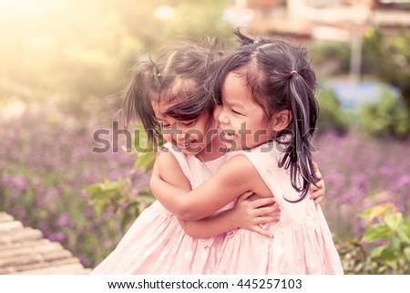 child two happy little girls...