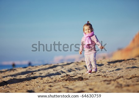 Child walking at the beach