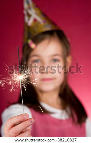 Child watching a cool firework, sparklers