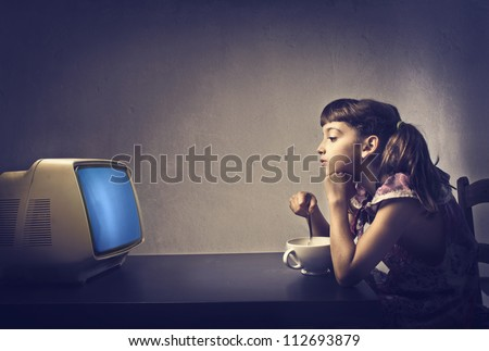 child watching tv during the...