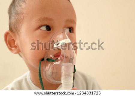 child wear nebulizer mask for breathing medication. asthma medication. #1234831723