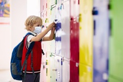 Child wearing face mask during corona virus and flu outbreak. Disease and illness protection for kids. Surgical masks for coronavirus prevention. School kid coughing. Little boy going to school.