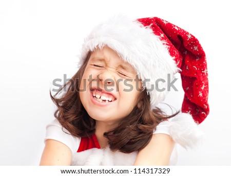 Child wearing santa claus christmas hat