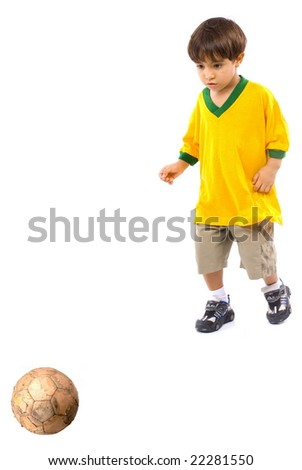 Child with a brazilian T-shirt playing football .