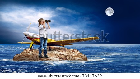 Child with airplane on the island in sea.