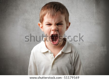 Child with angry expression - stock photo