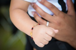 Child with Azabache jewelry