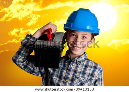 child with blue helmet and tools case on big sun background