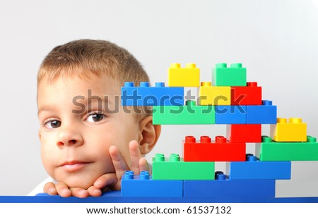 Child with construction plastic bricks
