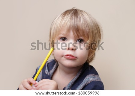 Child with crayon, arts and crafts