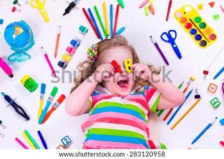 Child with draw and paint supplies. Kids happy to go back to school. Preschool kid learning and studying. Creative children at kindergarten. Office supply objects collection.