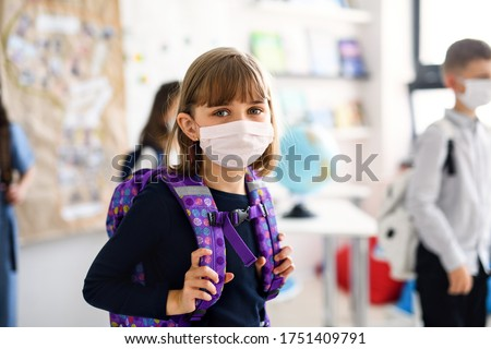 Child with face mask going back to school after covid-19 quarantine and lockdown.