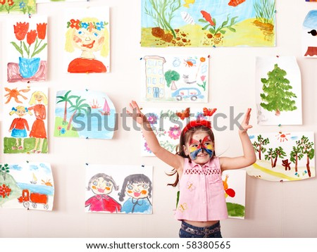 Child with  face painting in play room. Preschooler.