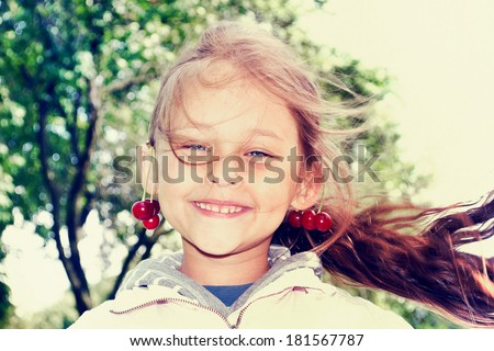 child with flying hair