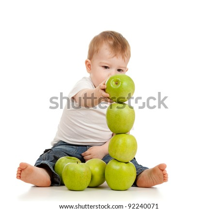 child with healthy food green apples
