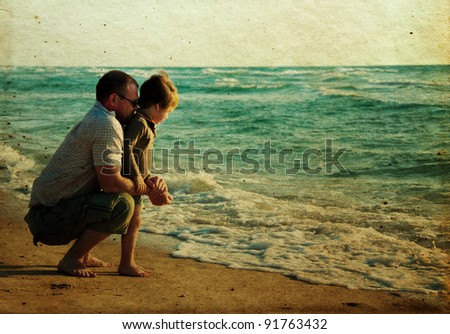 child with his father at sea. Photo in old color image style.