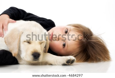 Child with Labrador retriever puppy