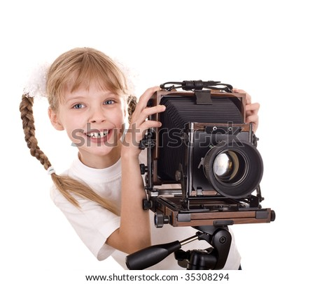 Child  with old wood large format digital camera. Isolated.