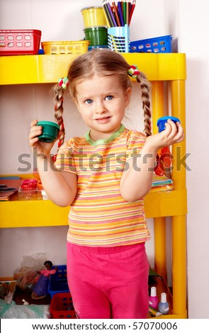 Child with paint in home.