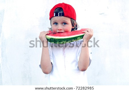 Child with part of watermelon, isolated on the white background
