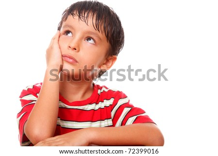 Child with pensive and sad expression over white background