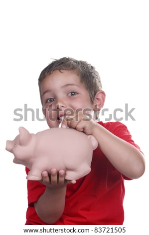 child with piggy bank on white background