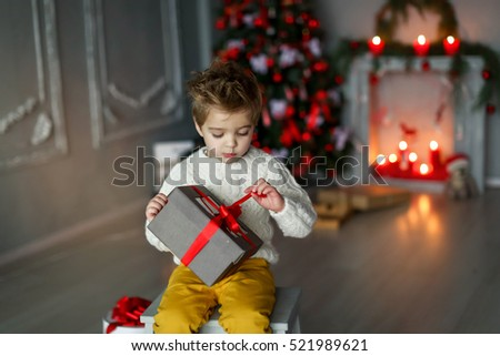 Child with presents for Christmas #521989621