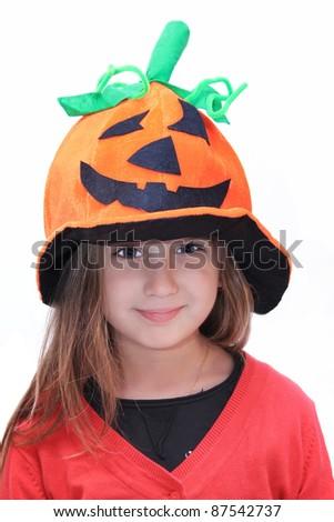 child with pumpkin hat