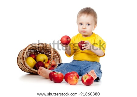 child with red apples; near basket