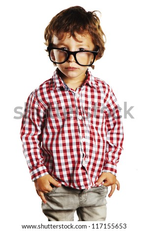 Child with rimmed glasses and hands in pockets. Portrait of child with plaid shirt isolated on white