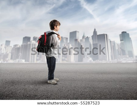 Child with rucksack with cityscape on the background