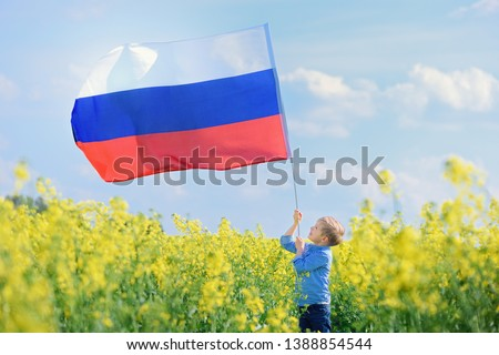 Child with the Russian flag, outdoor #1388854544