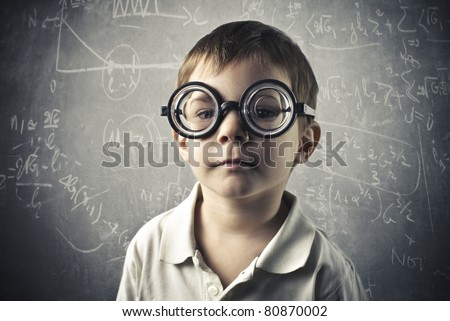 Child with thick eyeglasses