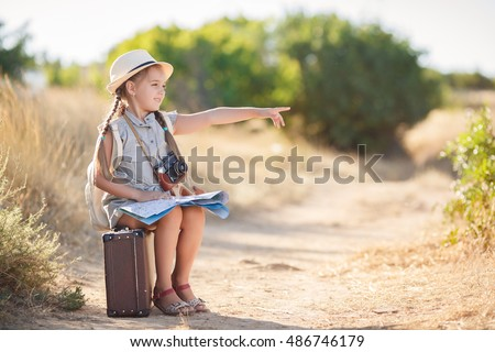 child with vintage suitcase and ...