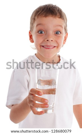 Child with water in glass isolated on white