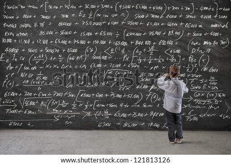 Child writing on a blackboard