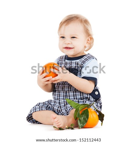 childhood and healthy food concept - cute toddler eating orange