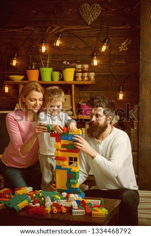Childhood concept. Child and family play with toy bricks, childhood. Early childhood development. Early childhood education.