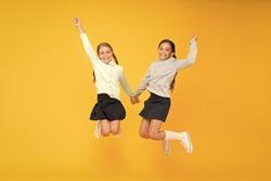Childhood happiness. School day fun cheerful moments. Kids cute students. Schoolgirls best friends excellent pupils. Schoolgirls tidy appearance school uniform. School friendship. September again.