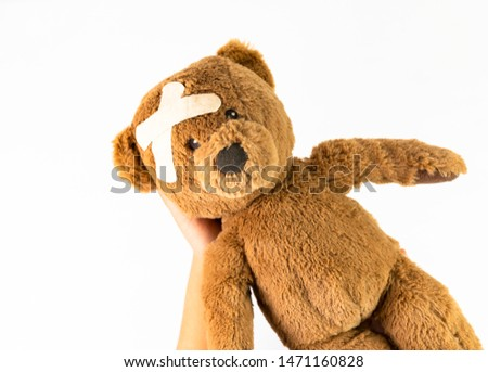 Childhood illness and sick kids concept with a adhesive bandages on its head to cover an injury with copy space