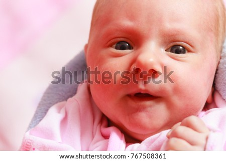 Childhood innocence concept. Little adorable newborn baby lying on bed with many blankets. #767508361