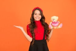 Childhood memories. Emotional intellect. Lovely child. Lovely small girl smiling happy face hold toy. Happy childhood. Imaginary friend. Little girl play with soft toy teddy bear. Child care.