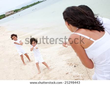 Children against parents competing at the beach