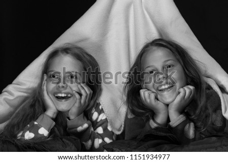 Children and fun time concept. Kids wearing red jammies in bed on black  background. d26690a7a