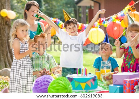 Children and happy birthday boy, cake lying on table #602619083