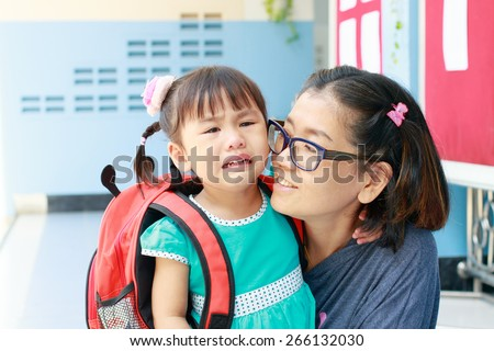 children and mother crying first day go to pre-kindergarten school