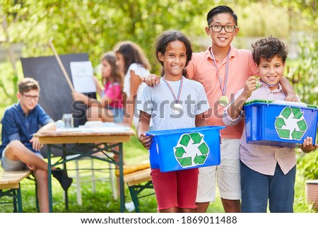 Children as proud environmentalists and as winners in an ecology recycling project Stock foto ©